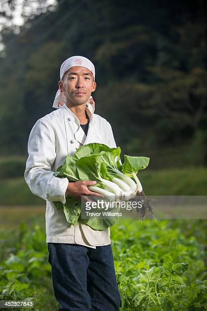 A chef showing vegetables from his garden