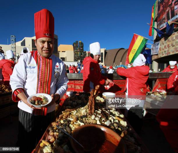 A chef shows a traditional soup dish named Kalapari during the celebration of the AndeanAmazonic New Year 5525 on June 21 2017 in Orinoca Bolivia