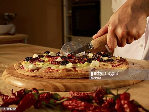 Chef Slicing Pizza