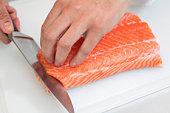 Chef slicing sushi