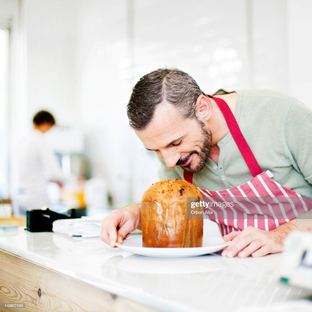 Chef smelling Panettone : Stock Photo