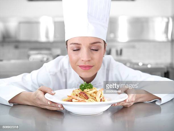 Chef smelling shrimp pasta
