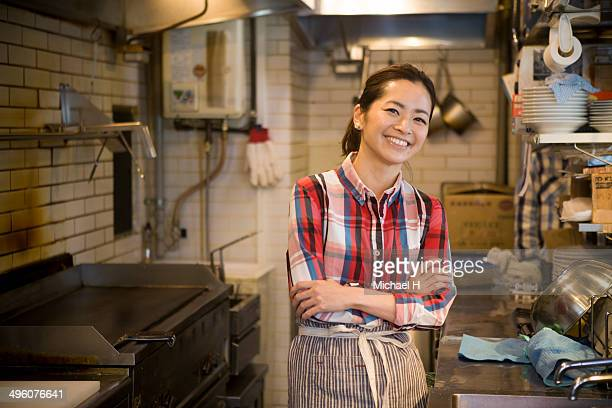 Chef smiling in restaurant kitchen