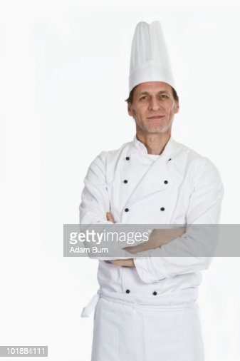A chef standing with arms crossed, portrait