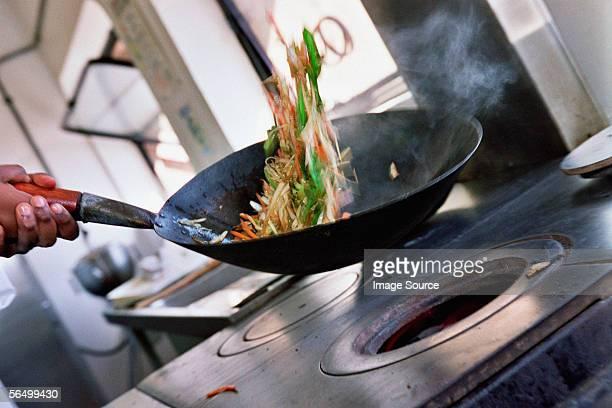 Chef stir-frying vegetables