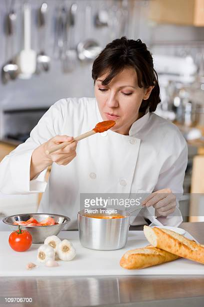chef tasting sauce
