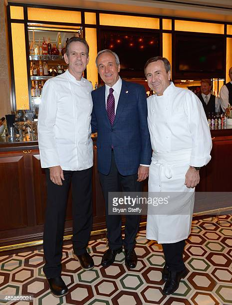 Chef Thomas Keller Keep Memory Alive foundation Founder Larry Ruvo and chef Daniel Boulud attend the celebration of the opening of db Brasserie at...