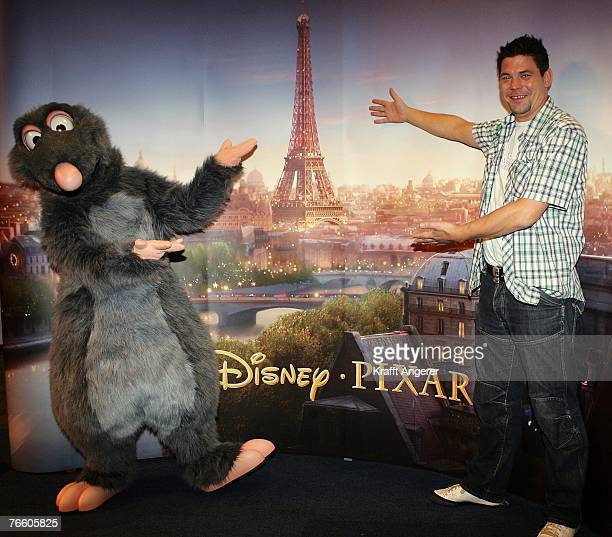 Chef Tim Maelzer and a costume Character pose at the photo call for the new movie Ratatouille at the CCH Congress Center on September 9 2007 in...