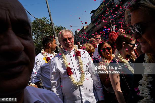 Chef to the President of the Republic of Finland Isto Tahvanainen walks with other chefs to various heads of states as they visit the spice market in...