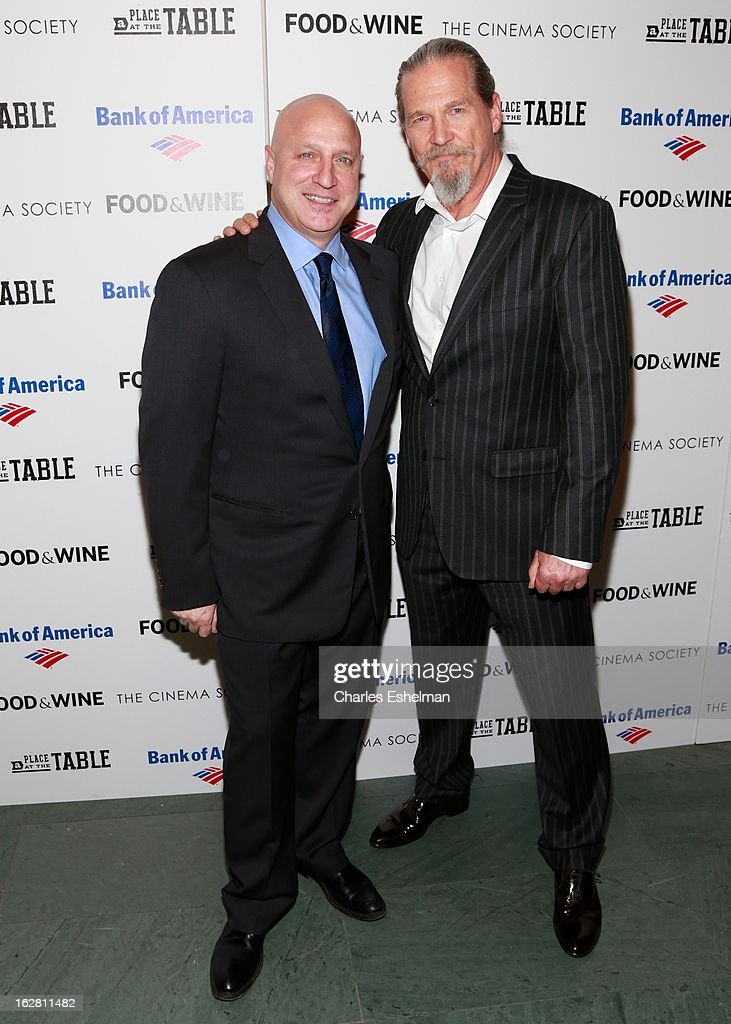 Chef <a gi-track='captionPersonalityLinkClicked' href=/galleries/search?phrase=Tom+Colicchio&family=editorial&specificpeople=4167072 ng-click='$event.stopPropagation()'>Tom Colicchio</a> and actor <a gi-track='captionPersonalityLinkClicked' href=/galleries/search?phrase=Jeff+Bridges&family=editorial&specificpeople=201735 ng-click='$event.stopPropagation()'>Jeff Bridges</a> arrive at Bank of America and Food & Wine with The Cinema Society present a screening of 'A Place at the Table' at the Celeste Bartos Theater at the Museum of Modern Art on February 27, 2013 in New York City.