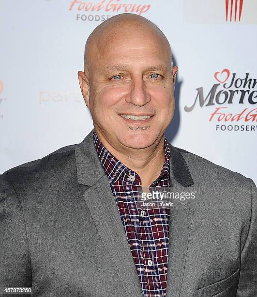 Chef Tom Colicchio attends the No Kid Hungry campaign fundraising dinner at Ron Burkle's Green Acres Estate on October 25 2014 in Beverly Hills...