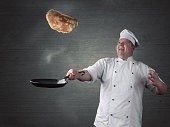 chef turns fresh pancakes in the pan