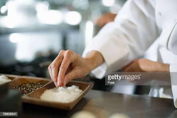 Chef Using Seasoning