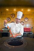 Chef Using Tandoor Oven