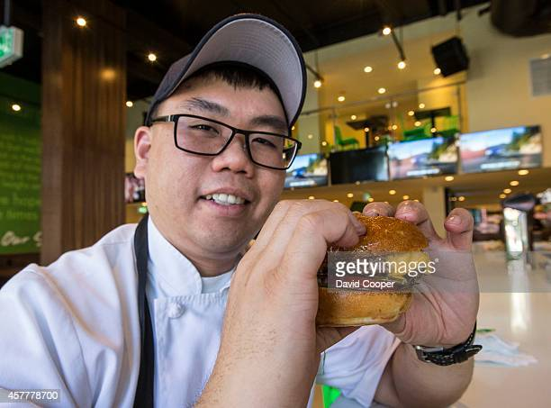 TORONTO ON OCTOBER 23 Chef Vincent Leung hold one of the signature burgers during a Sneak peak tour of the first Wahlburgers restaurant of the chain...