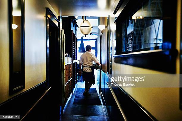 Chef walking down restaurant hallway