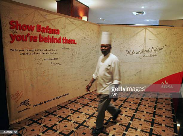 A Chef walks past a banner singed by Bafana Bafana supporters on May 15 2010 at the Southern Sun Hotel in Sandton Johannesburg The hotel will be the...