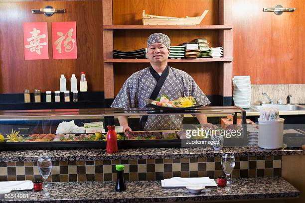Chef with sushi