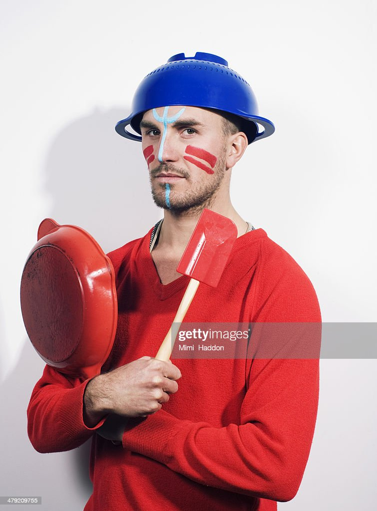 Chef with Tribal Make Up Holding Frying Pan