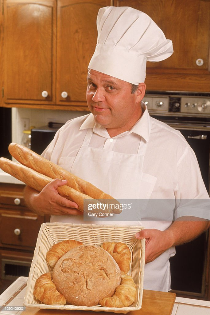 Chef with variety of bread : Stock Photo