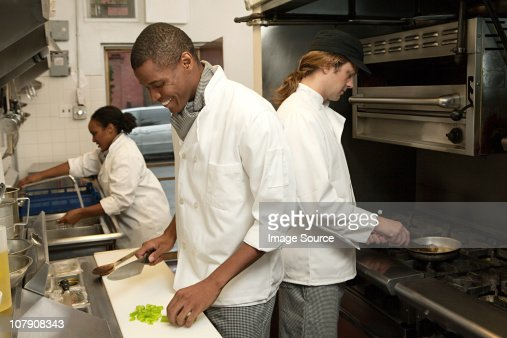 Chef working in commercial kitchen : Stock Photo