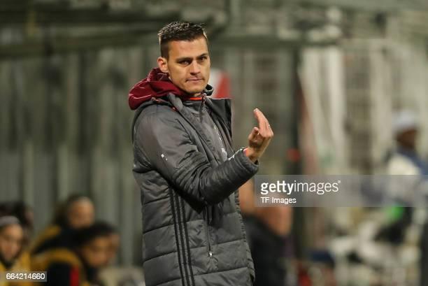 ChefHead coach Thomas Woerle of Bayern Munich gestures during the Champions League match between Bayern Munich and Paris Saint Germain at Municipal...