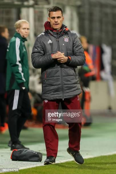 ChefHead coach Thomas Woerle of Bayern Munich looks on during the Champions League match between Bayern Munich and Paris Saint Germain at Municipal...
