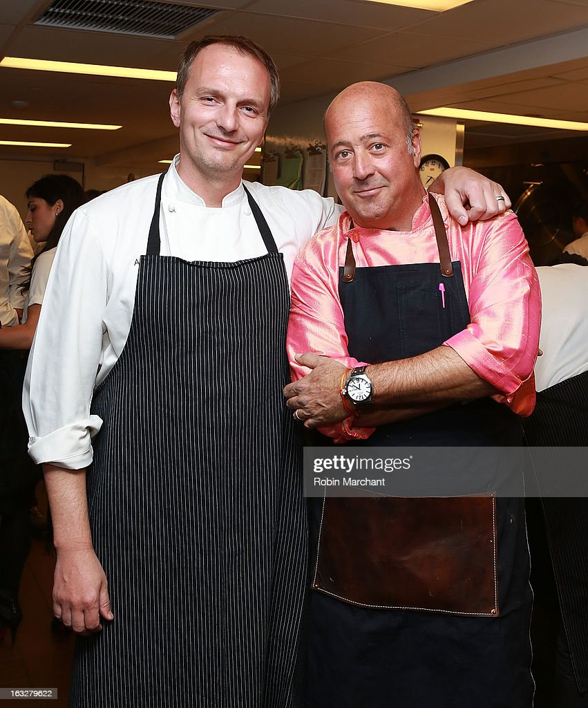 Chefs Andrew Carmellini (L) and Andrew Zimmern attend the 2013 Dinner For A Better New York at Riverpark Restaurant on March 6, 2013 in New York City.