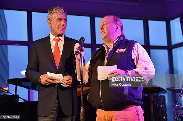 Chefs Anthony Bourdain and Mario Batali speak onstage at The Supper hosted by Mario Batali with Anthony Bourdain on June 2 2016 in New York City