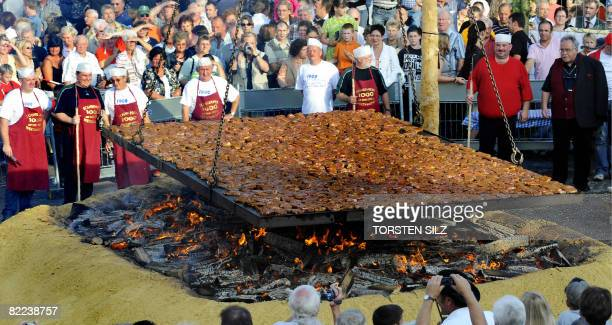 Chefs attempt to beat the world record in barbecuing steaks in the southern German town of BubachCalmesweiler on August 9 2008 The chefs grilled 1235...