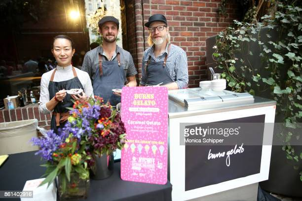 Chefs Aya Ikeda and Daniel Burns pose with their Carmel Gelato during Family Ice Cream Fundae hosted by Mario Batali and Ayesha Curry at Private Park...