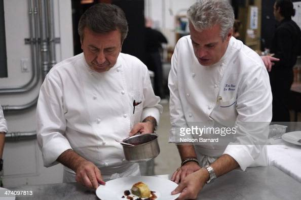Chefs Daniel Boulud and Eric Ripert prepare food at the Ocean Liner dinner hosted by Anthony Bourdain Frederic Morin David McMillan Andrew Carmellini...