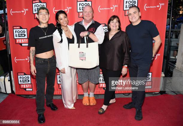 Chefs Danny Bowien Angie Mar Mario Batali Ina Garten and Jean Georges Vongerichten pose with a brand giftt bag at EAT Food Film Fest at Bryant Park...