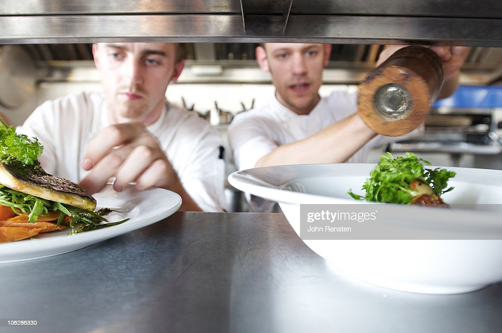 chefs doing kitchen preparation and service