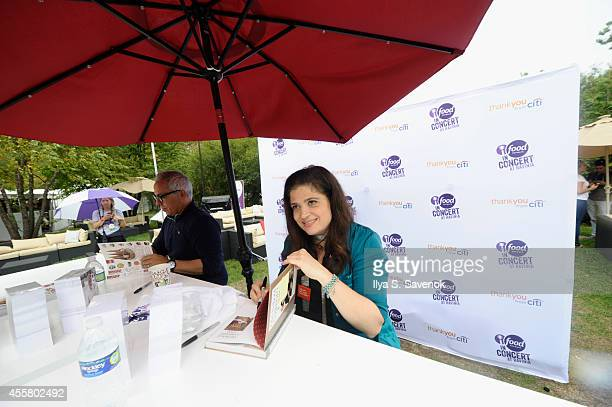 Chefs Geoffrey Zakarian and Alex Guarnaschelli sign books at Food Network in Concert on September 20 2014 in Chicago United States