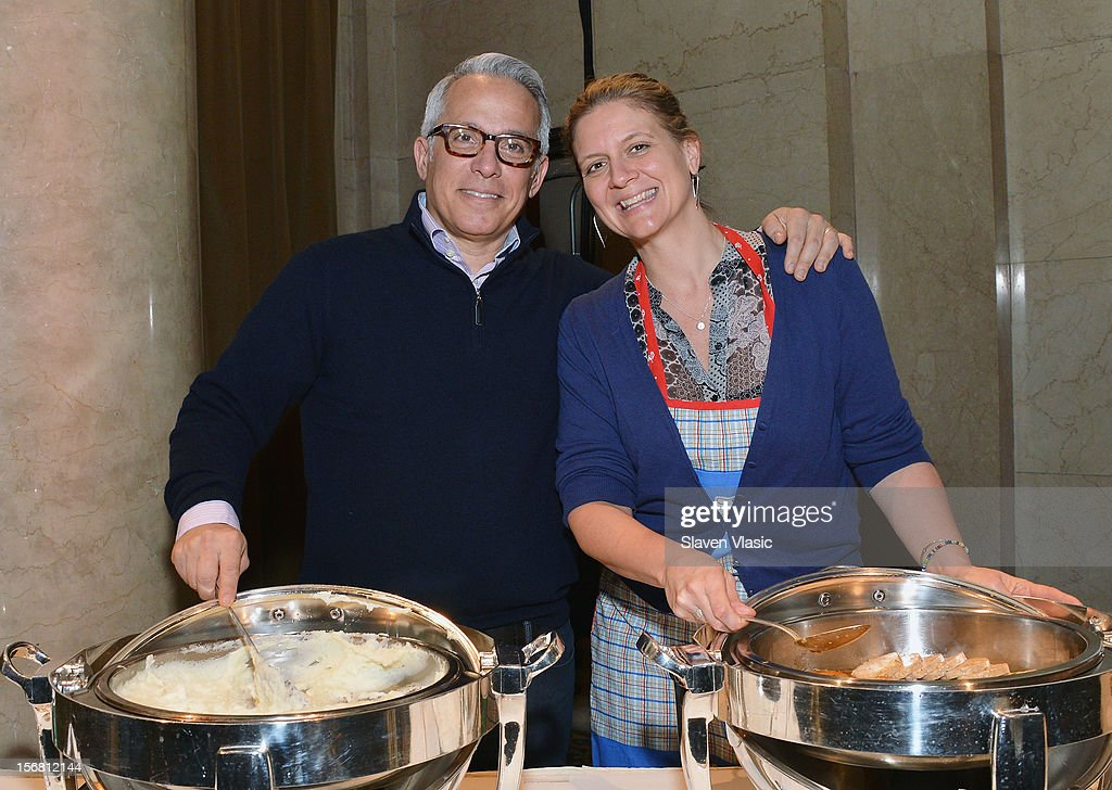 Chefs Geoffrey Zakarian and Amanda Freitag volunteer during the Our Table Is Yours - A Thanksgiving Day benefit at Cipriani, Wall Street on November 21, 2012 in New York City.