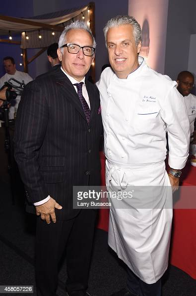 Chefs Geoffrey Zakarian and Eric Ripert attend City Harvest's 20th annual Bid Against Hunger on October 29 2014 in New York City