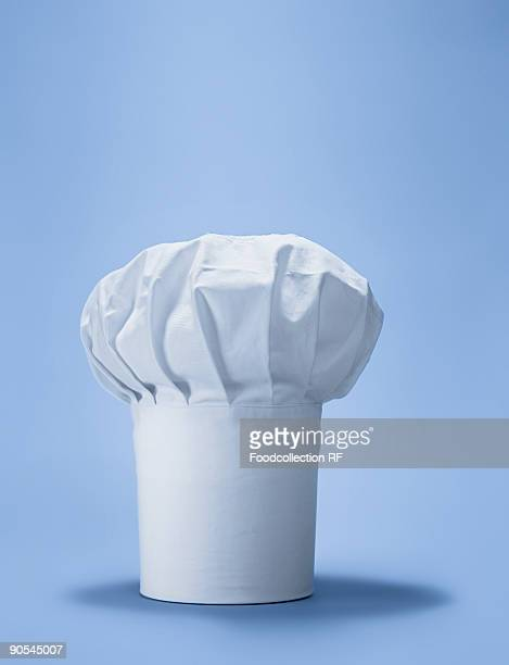 Chef's hat on blue background, close up