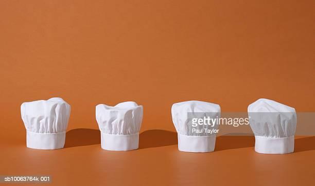 Chef's hats in row, studio shot