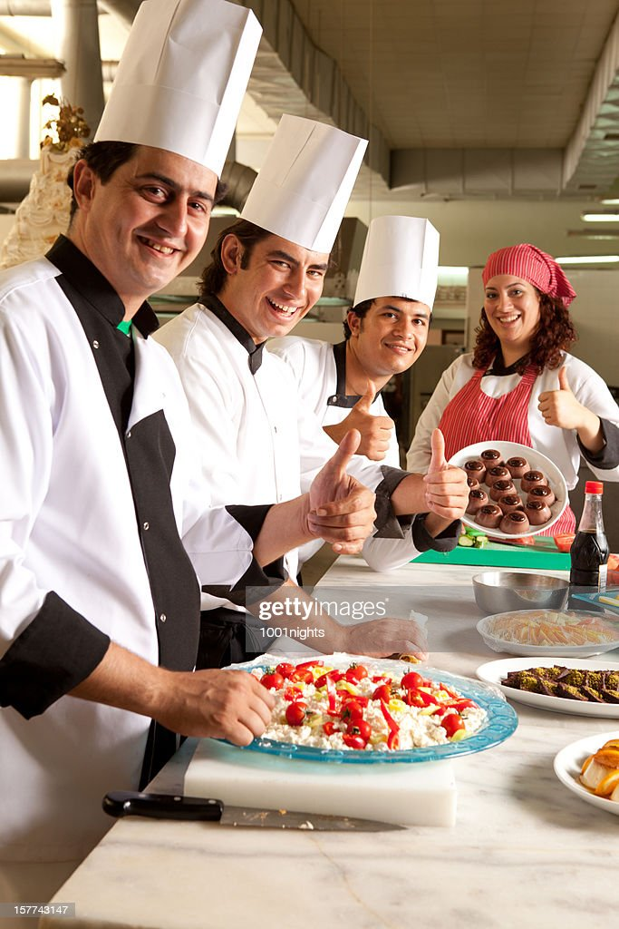 Chefs in a kitchen : Stock Photo