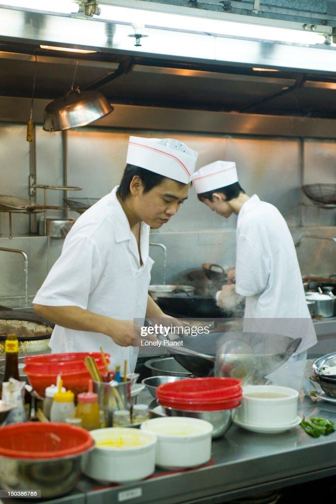 Chefs in kitchen of Super Star Seafood Restaurant, Causeway Bay. : Stock Photo