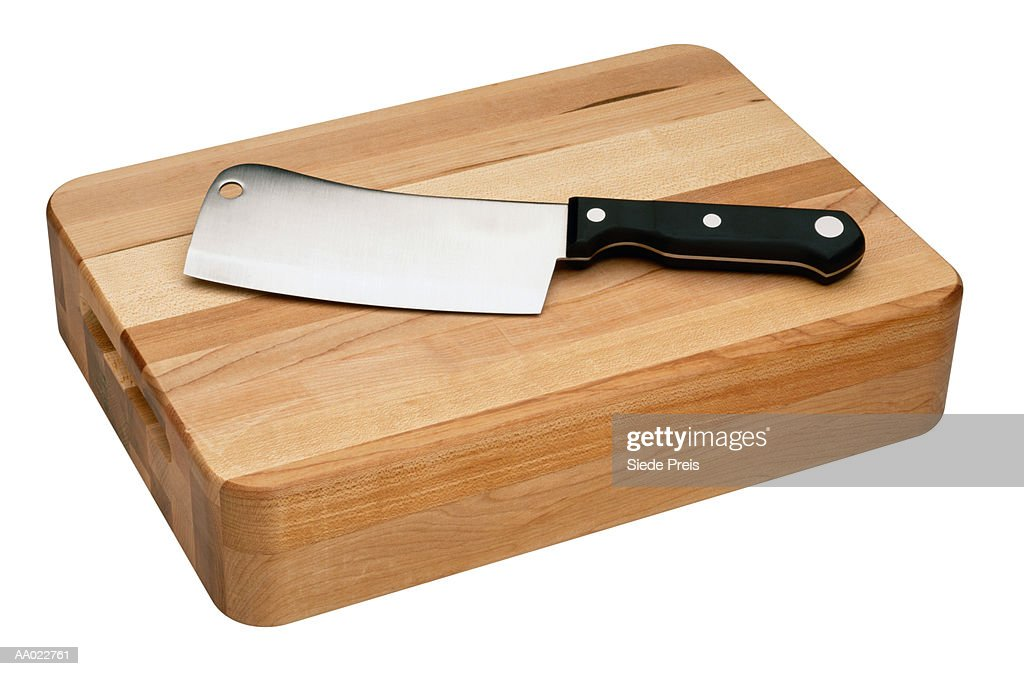 chefs knife on a cutting board stock photo getty images. Black Bedroom Furniture Sets. Home Design Ideas