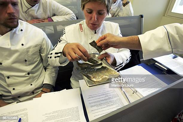Chefs look at the skin of fried fish used as a decoration in the recipe for Rib of Turbot with lager beer tempura and monk fish tripe sauce and wild...