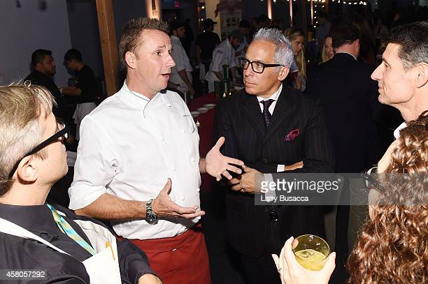 Chefs Marc Murphy and Geoffrey Zakarian attend City Harvest's 20th annual Bid Against Hunger on October 29 2014 in New York City