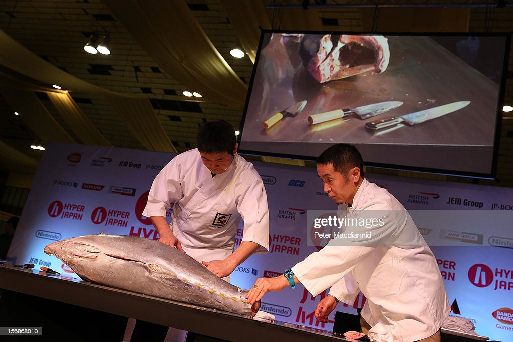 Chefs prepare a tuna at The Hyper Japan event at Earls Court on November 23, 2012 in London, England. The show is the UK's biggest Japanese Culture event, with stalls selling clothing and artwork. live music, Japanese food and computer gaming areas are also on show. Many attendees dress up as anime characters or in the lolita fashion widespread in Japan.