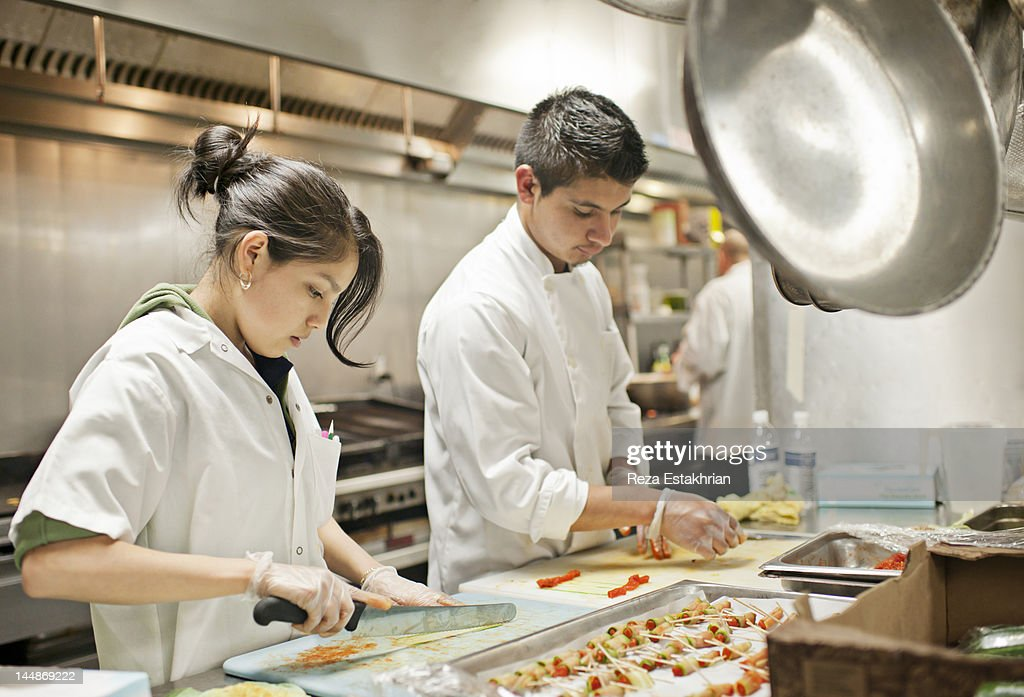 Chefs prepare appetizers : Stock Photo