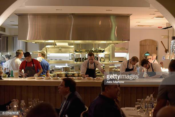 Chefs prepare food at a Dinner Hosted By Marc Vetri And Giovanni Rocchio Part of the Taste Fort Lauderdale Seriesduring 2016 Food Network Cooking...