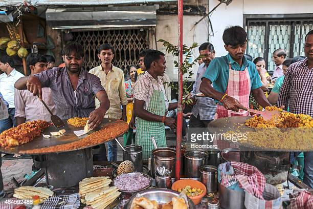 Chefs prepare street food at stalls near Crawford Market in Mumbai India on Thursday Feb 26 2015 India's Finance Minister Arun Jaitley will present...