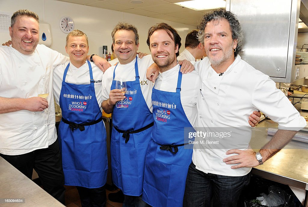 Chefs Richard Corrigan, Rainer Becker, Mark Hix, Brett Graham and Peter Gordon pose in the kitchen at the 'Who's Cooking Dinner?' charity event, featuring 20 of the capital's finest chefs cooking dinner for 200 diners in aid of leukaemia charity Leuka, at the Four Seasons Hotel on March 4, 2013 in London, England.