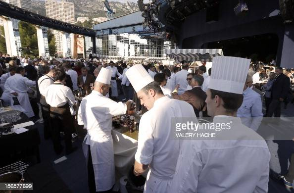 Chefs stand at an ephemeral market during the festivities marking the 25th anniversary of French chef Alain Ducasse's restaurant 'Le Louis XV' on...